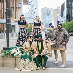Indian wedding party in blue, gold, and green