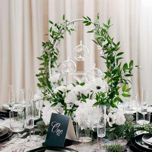 Modern black, white, and greenery wedding table
