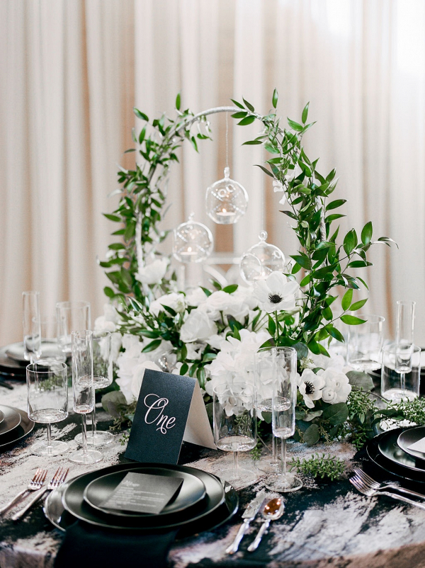 Modern black, white, and greenery wedding table