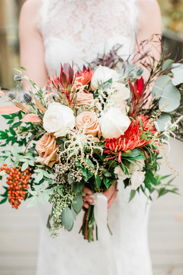 Wild peach and red bridal bouquet