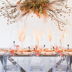 Modern romantic wedding table with suspended greenery
