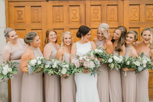 Bridesmaids in long neutral hued gowns