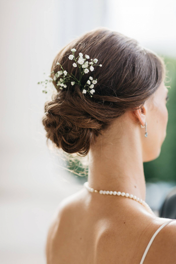 Bridal updo with baby's breath