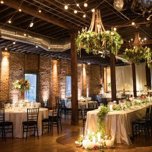 Industrial wedding venue with floral covered chandeliers