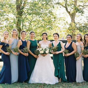 Blue, teal, and gray mismatched bridesmaid dresses