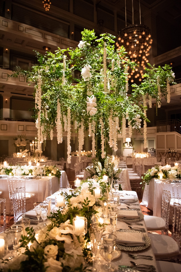 Luxe wedding reception with oversized draping floral centerpieces