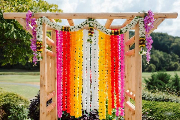 Colorful hanging flower ceremony backdrop