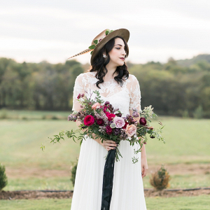 Indie bride with feather hat
