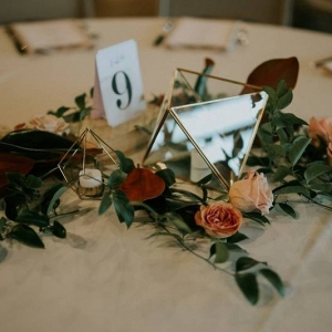 Geometric vase and greenery wedding centerpiece
