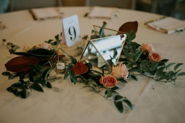 Geometric vase and greenery wedding centerpiece