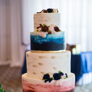 Blue and red painted wedding cake
