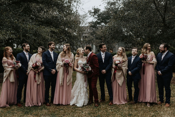 Winter wedding party with long gowns and shawls