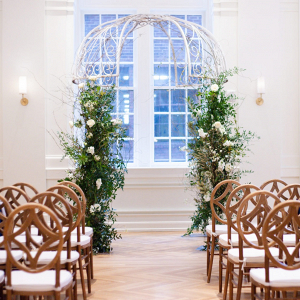 Metal wedding arbor with greenery
