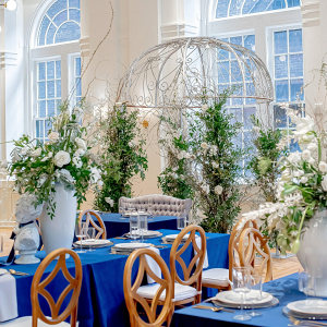 Blue and silver wedding reception with urn centerpieces