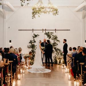 Romantic greenery covered wedding ceremony