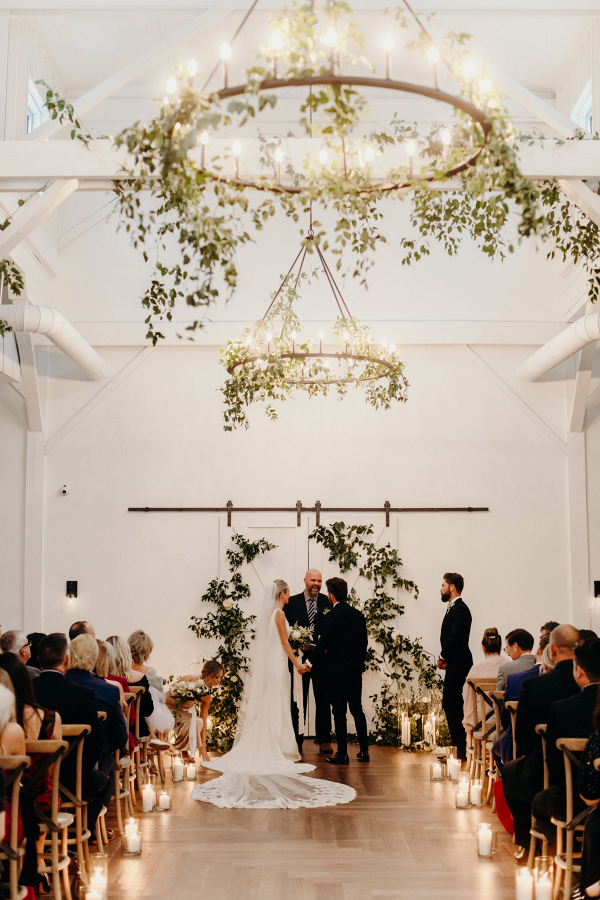 Romantic greenery covered wedding ceremony