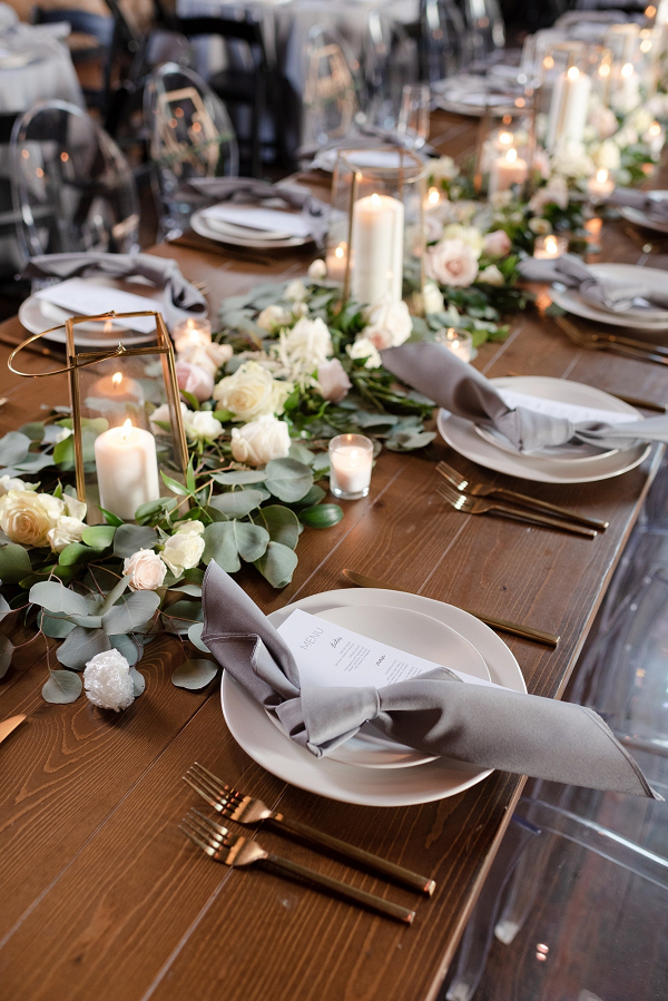 Floral table runner with geometric lanterns