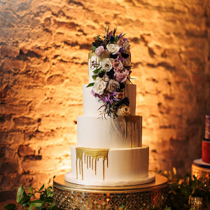 Drip wedding cake with fresh florals