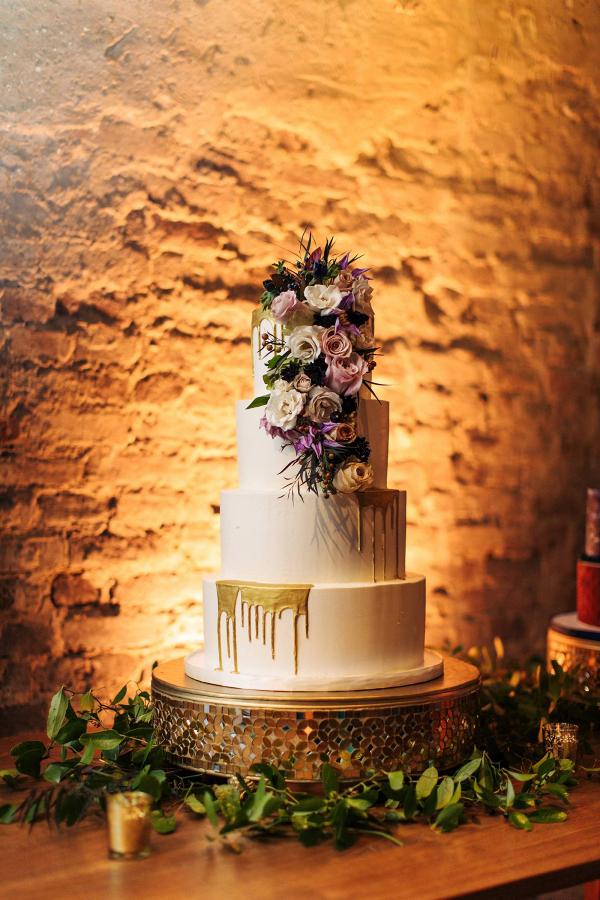 Drip wedding cake with fresh florals