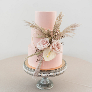 Pink wedding cake with pampas grass