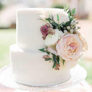 Small white wedding cake with fresh florals