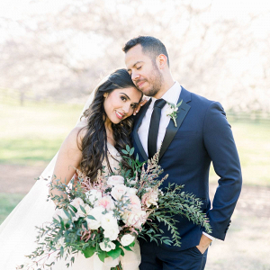 Romantic bride and groom at pink and white wedding