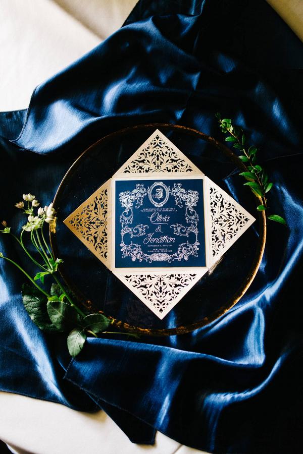 Ornate navy and gold wedding invitation