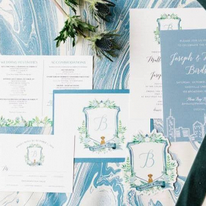 Watercolor monogram crest wedding invitation