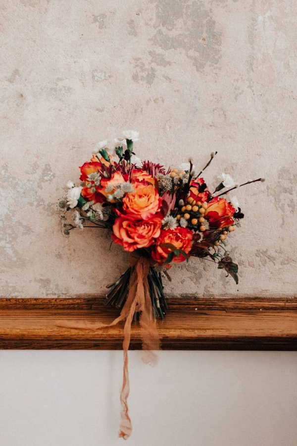 Vibrant orange bridal bouquet