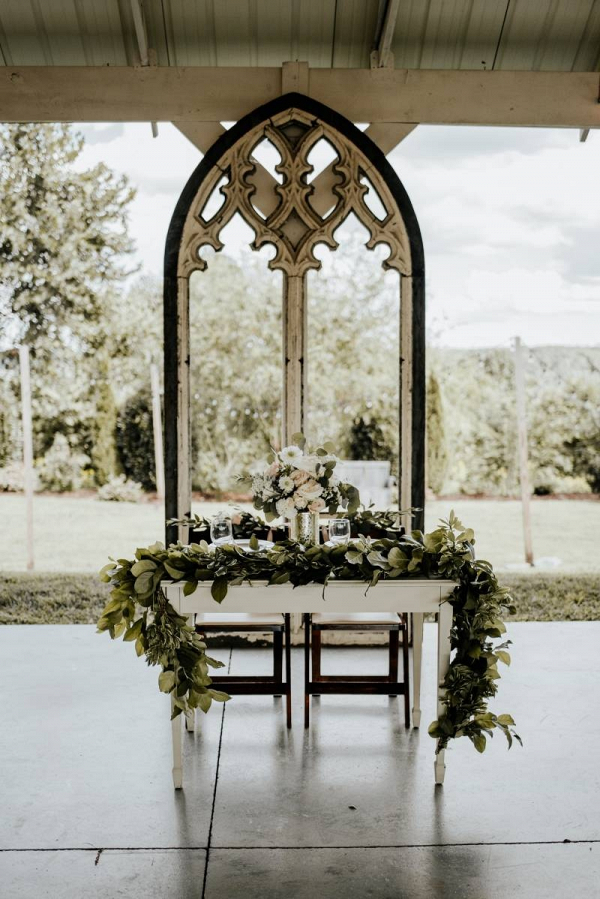 Vintage arch sweetheart table backdrop