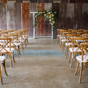 Barn wedding ceremony with arch