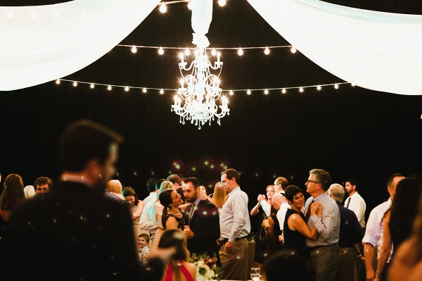 Reception dancing under string lights