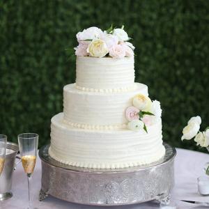 Classic white wedding cake with blush flowers