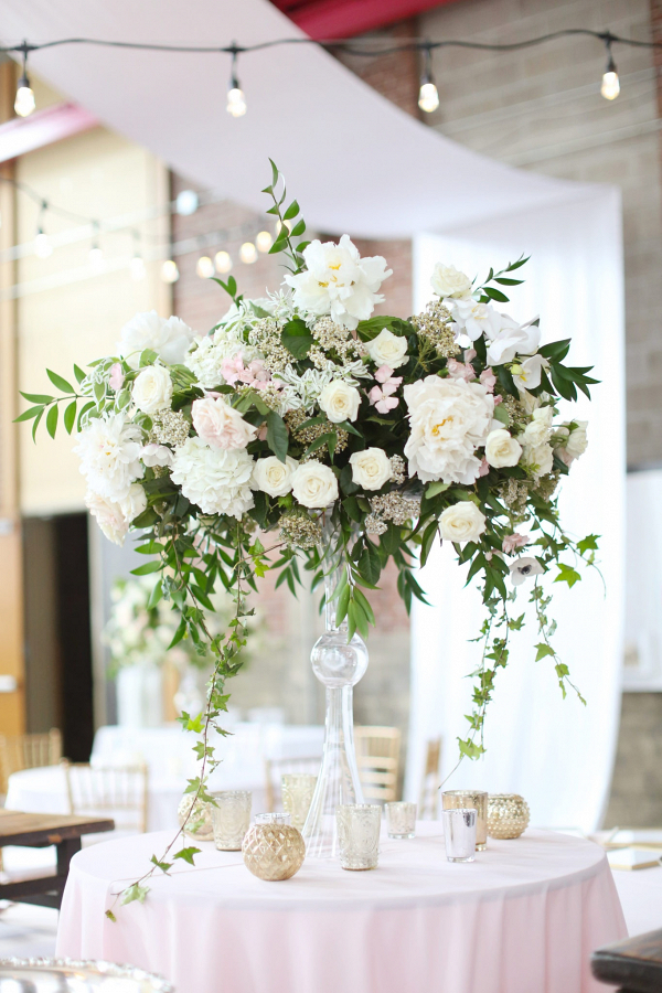Tall white and blush wedding centerpiece