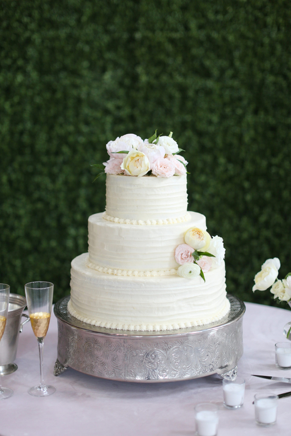 Classic white wedding cake with blush flowers