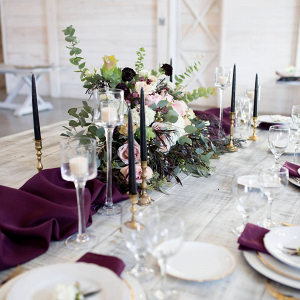 Winter tablescape with purple runner and taper candles