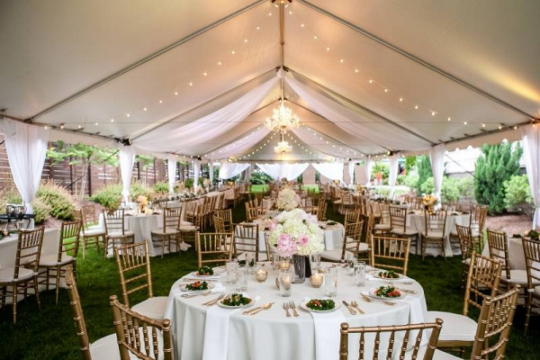 Pink and white tented reception