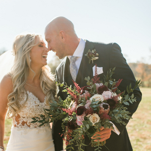 Nashville bride and groom with burgundy bouquet