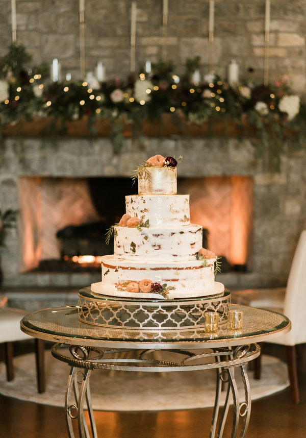 Large semi-naked wedding cake with doughnut decoration
