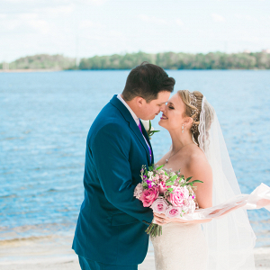 bride and groom on beach at Paradise Cove