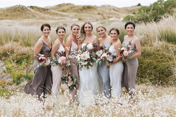 Bridesmaids in neutral dresses