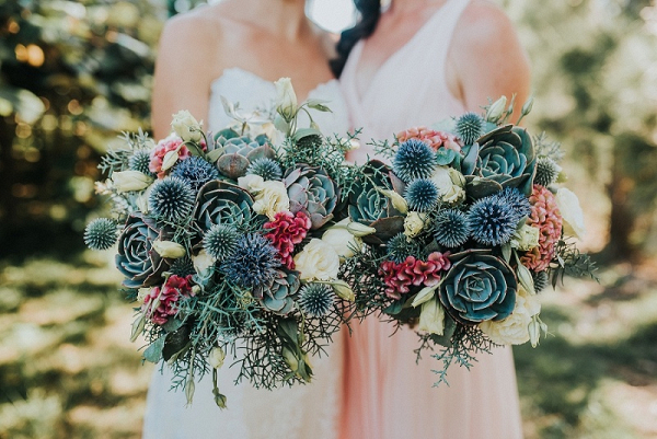 Bride and bridesmaid with rustic bouquets