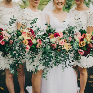 Bridesmaids in lace cut out dresses