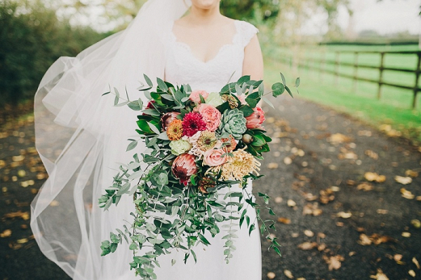 Bride holding oversized bouquet