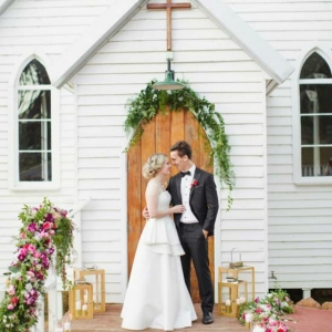 Bride & Groom With Little White Church