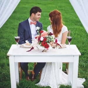 Newlyweds At Sweetheart Table