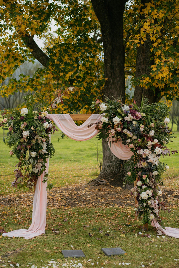 Floral and draping ceremony arch