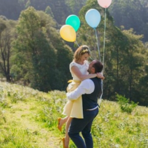 Newlyweds With Balloons