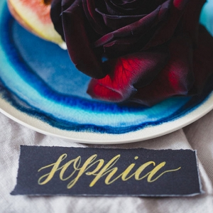Gold On Black Calligraphy Place Card
