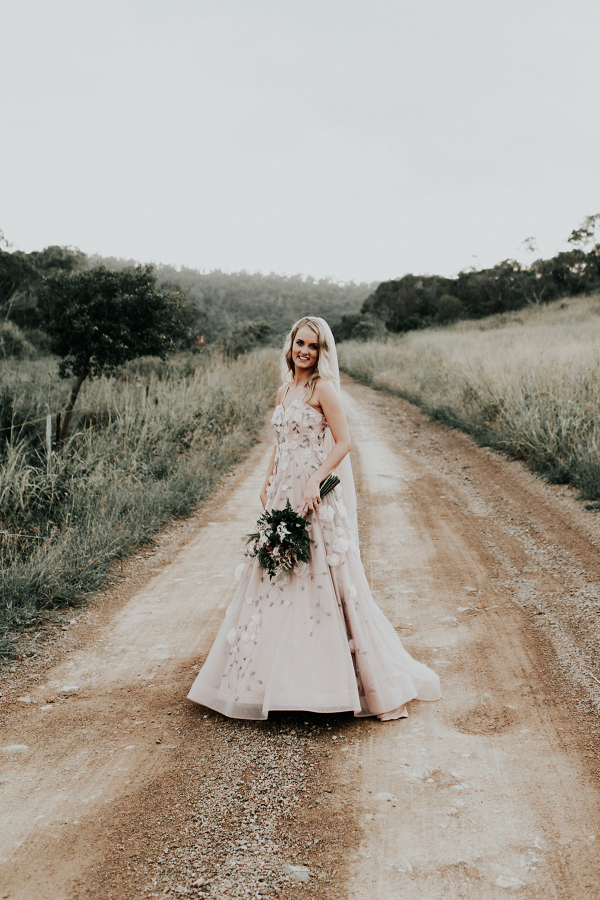 Bride In Blush Wedding Gown